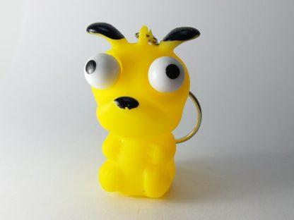 žuta igračka privezak pritiskom iskaču oči