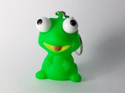 zelena žaba privezak pritiskom na žabu iskaču joj oči