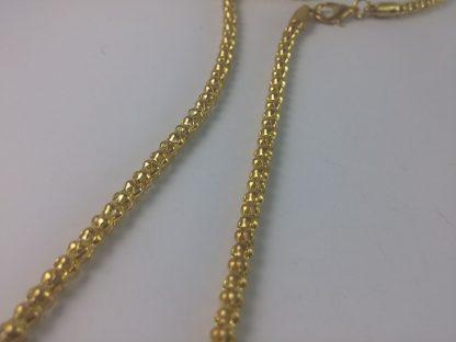 Kvalitetna ogrlica u zlatnoj boji čovek sa tegovima bučicama