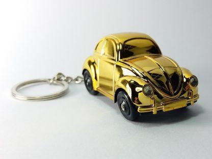 žuti autić privezak za ključeve zlatni hrom nilk privezak